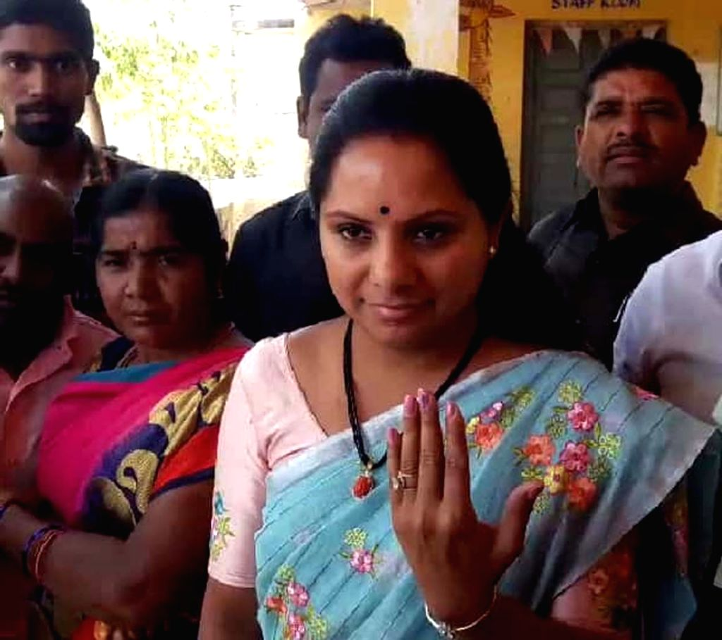 TRS MP from Nizamabad, K. Kavitha shows her inked finger after casting her vote for elections to the first phase of the three-phased Mandal Parishad Territorial Constituencies (MPTC) and ...
