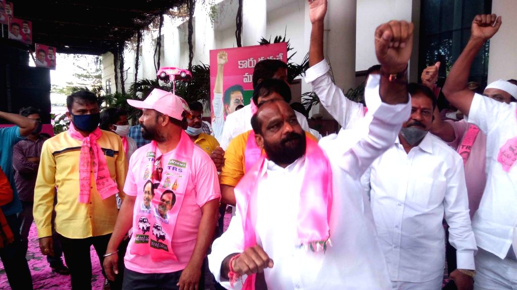 TRS workers celebrate the party's performance in the Greater Hyderabad Municipal Corporation (GHMC) elections while counting of votes is underway, in Hyderabad on Dec 4, 2020. Ruling TRS ...
