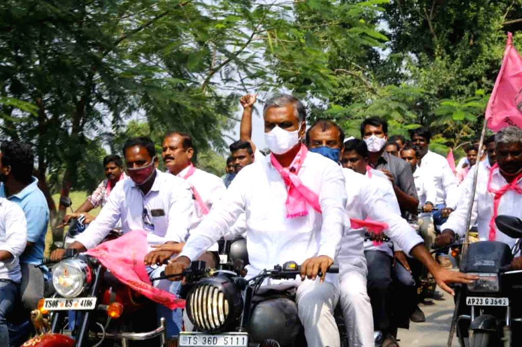 TRS workers led by Telangana Minister and party leader T. Harish Rao participate in a massive motorcycle rally to campaign for Dubakka bypolls, in Dubbaka on Oct 27, 2020. - T. Harish Rao