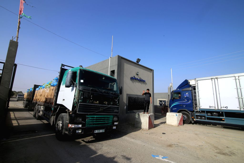 : Trucks are seen at the gate of the Kerem Shalom Crossing in the southern Gaza Strip city of Rafah, on Oct. 21, 2018. Israeli Defense Minister Avigdor Lieberman ...
