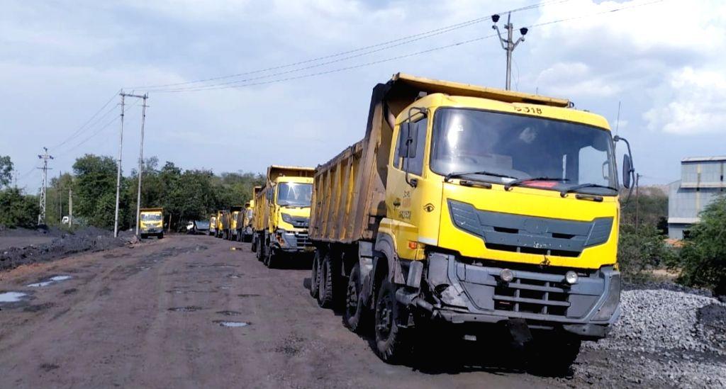Trucks outside a coal mine in Dipka of Chhattisgarh's Korba district. (File Photo: IANS)
