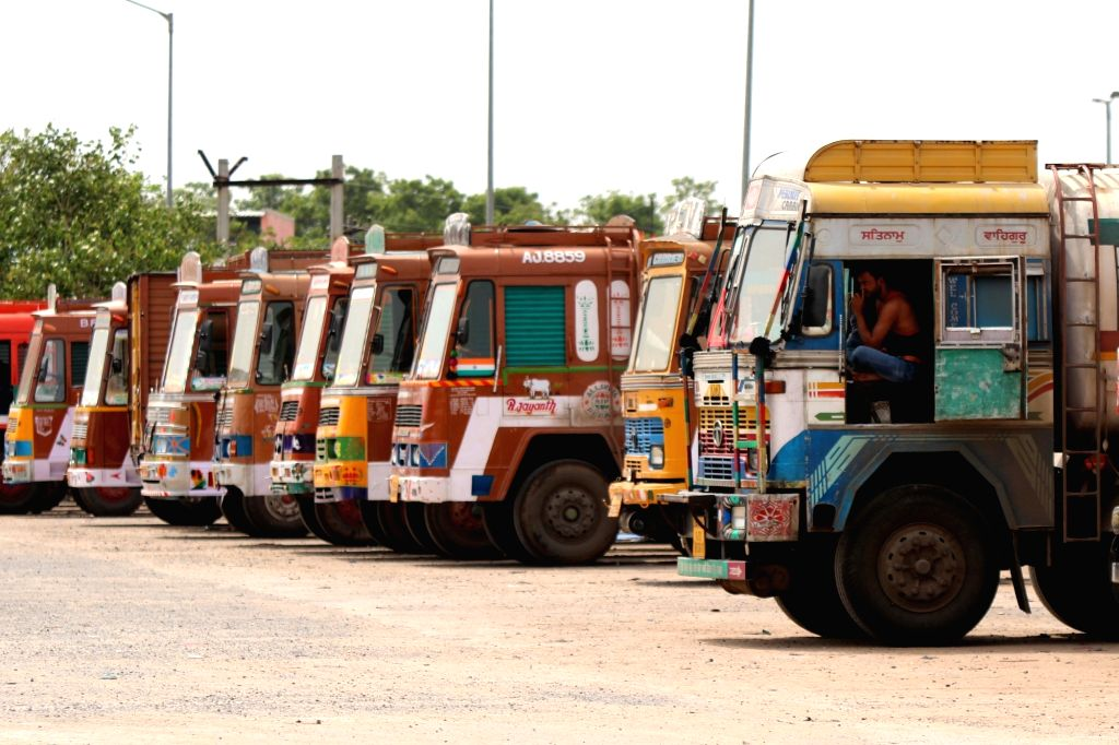 Trucks remain parked in a Chennai depot on July 20, 2018. Over 90 lakh trucks and around 50 lakh buses, tempos and tourist vehicles went off the roads on Friday as their owners began an ...