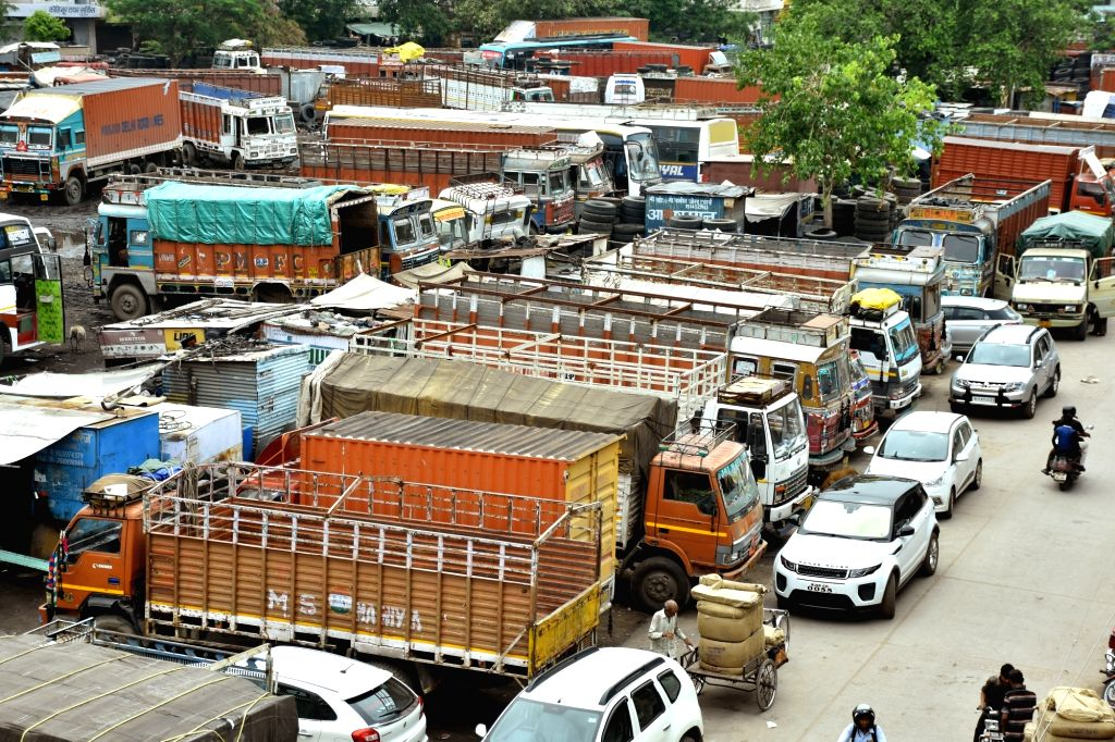 Trucks remain parked in a Jaipur depot on July 20, 2018. Over 90 lakh trucks and around 50 lakh buses, tempos and tourist vehicles went off the roads on Friday as their owners began an ...
