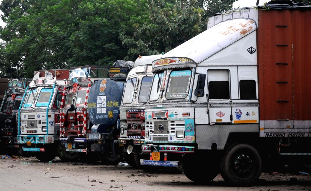 Trucks remain parked in an Amritsar depot on July 20, 2018. Over 90 lakh trucks and around 50 lakh buses, tempos and tourist vehicles went off the roads on Friday as their owners began an ...