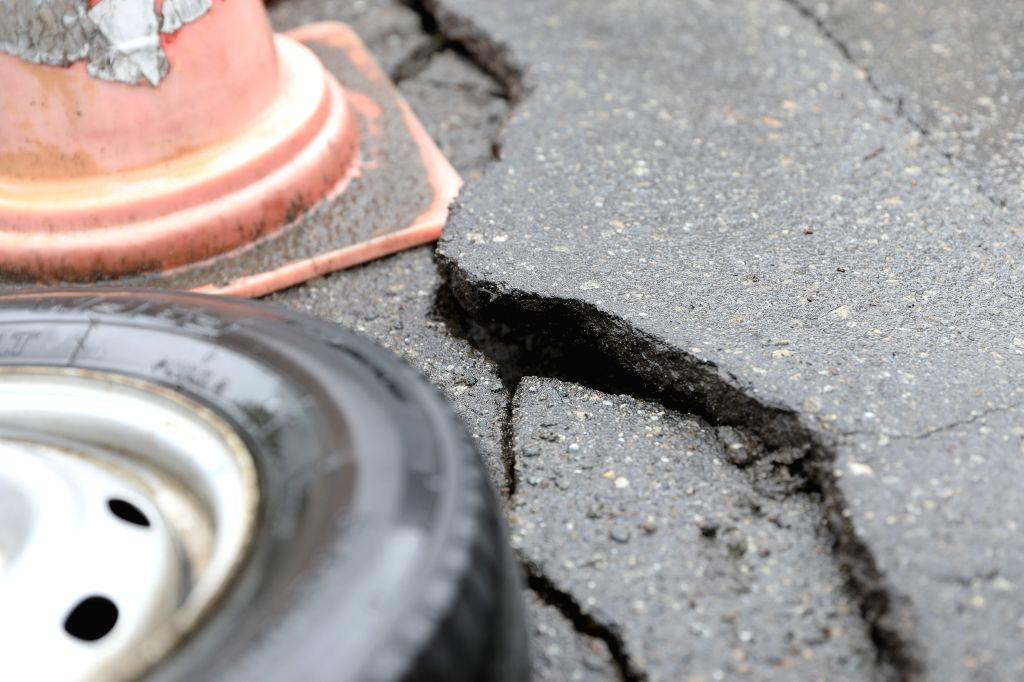 TSURUOKA, June 19, 2019 (Xinhua) -- Photo taken on June 19, 2019 shows the cracks on a road after an earthquake in Tsuruoka, Yamagata Prefecture, Japan. A 6.7-magnitude earthquake striking Japan's northeastern region late Tuesday left at least 15 peo