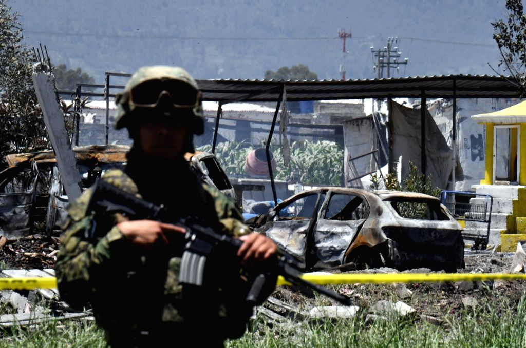 TULTEPEC (MEXICO), July 5, 2018 A soldier guards an area affected by explosions at a small fireworks factory in La Saucera, a neighborhood on the outskirts of Tultepec, Mexico, on July 5, ...