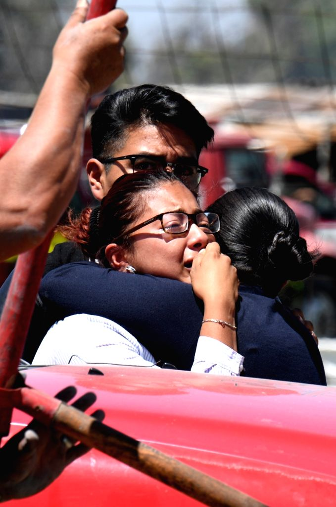 TULTEPEC (MEXICO), July 5, 2018 A woman reacts after explosions at a small fireworks factory in La Saucera, a neighborhood on the outskirts of Tultepec, Mexico, on July 5, 2018. Two ...