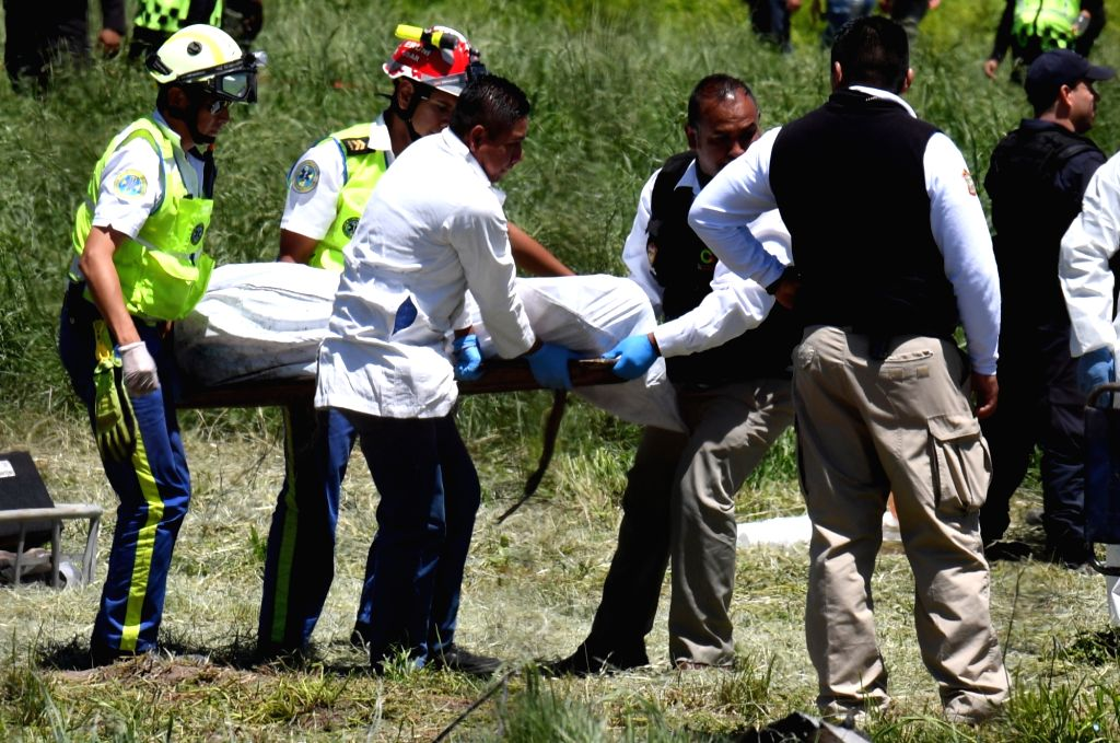 TULTEPEC (MEXICO), July 5, 2018 Rescuers carry the body of a victim after explosions at a small fireworks factory in La Saucera, a neighborhood on the outskirts of Tultepec, Mexico, on ...