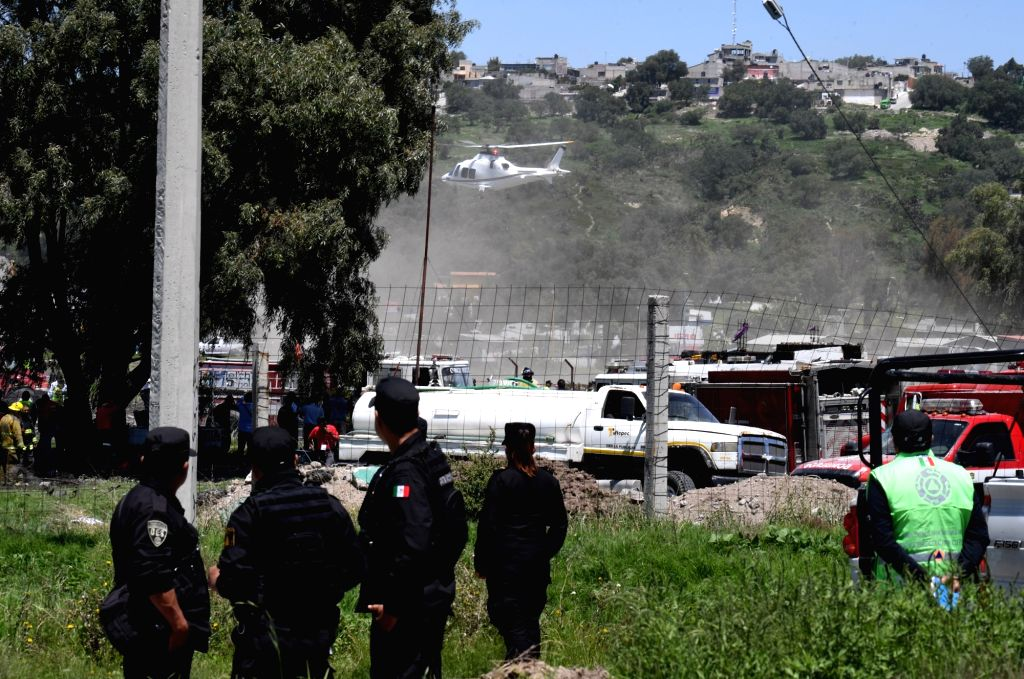 TULTEPEC (MEXICO), July 5, 2018 Security members guard an area affected by explosions at a small fireworks factory in La Saucera, a neighborhood on the outskirts of Tultepec, Mexico, on ...