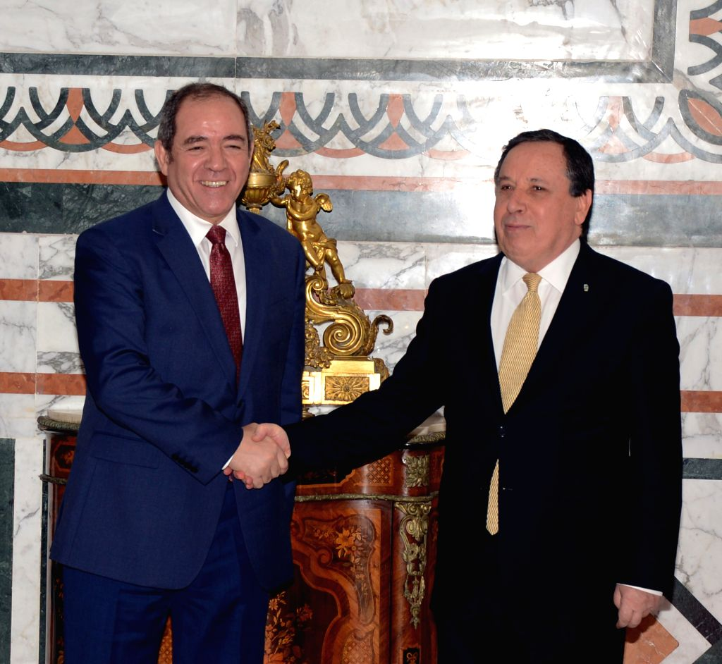 TUNIS, April 26, 2019 - Tunisian Foreign Minister Khemaies Jhinaoui (R) shakes hands with visiting Algerian Foreign Minister Sabri Boukadoum in Tunis, Tunisia, April 26, 2019. Tunisian Foreign ... - Khemaies Jhinaoui