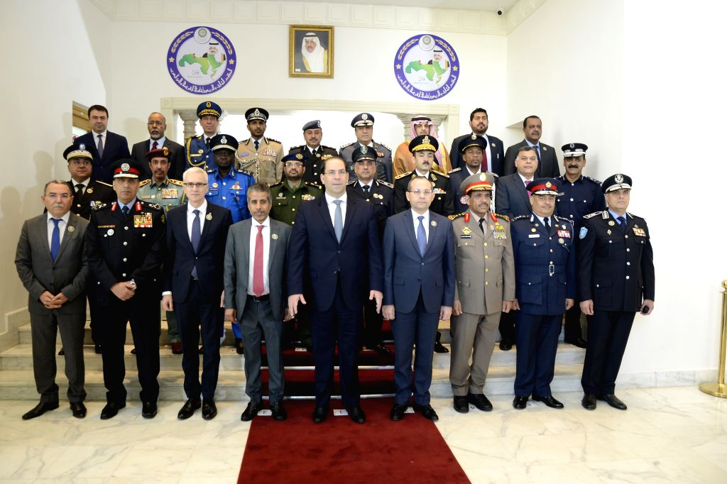 TUNIS, Dec. 12, 2019 - Tunisian Prime Minister Youssef Chahed (C, front) poses for photos with guests attending the 43rd Conference of Arab Police and Security ers in Tunis, Tunisia, Dec. 11, ... - Youssef Chahed