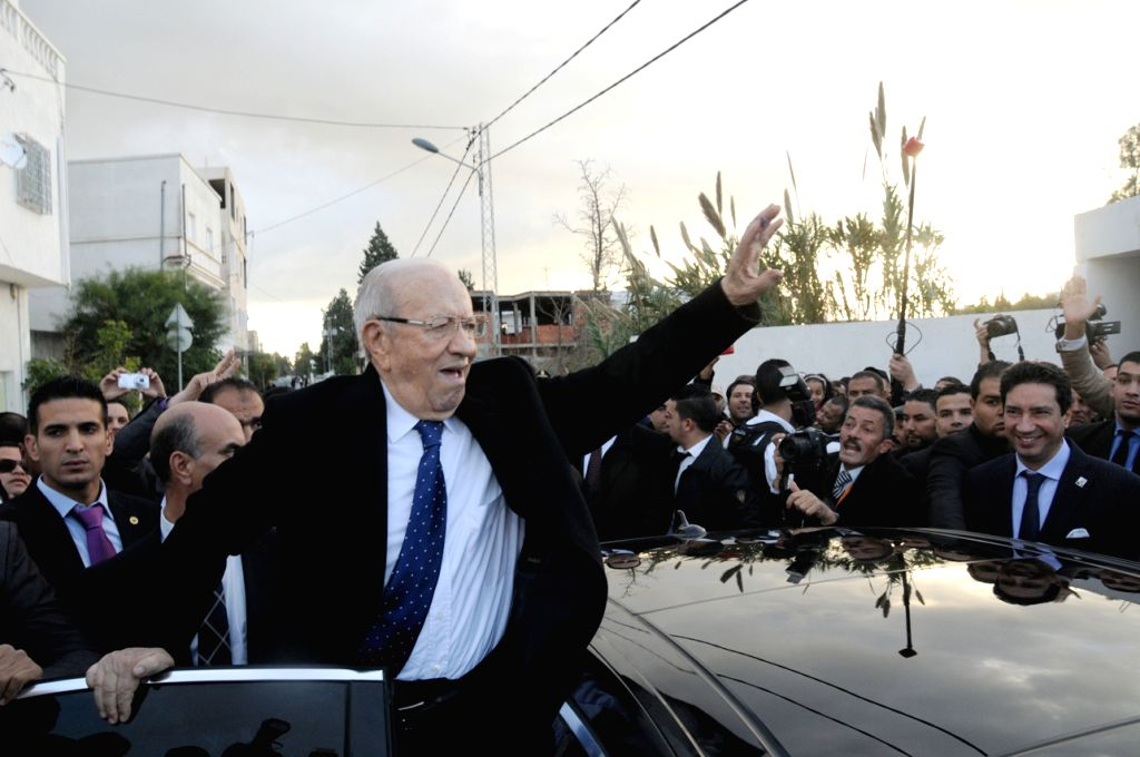 Tunisian presidential candidate Beji Caid Essebsi, leader of the anti-Islamist Nidaa Tounes party, leaves after casting his vote at a polling station in Tunis, capital