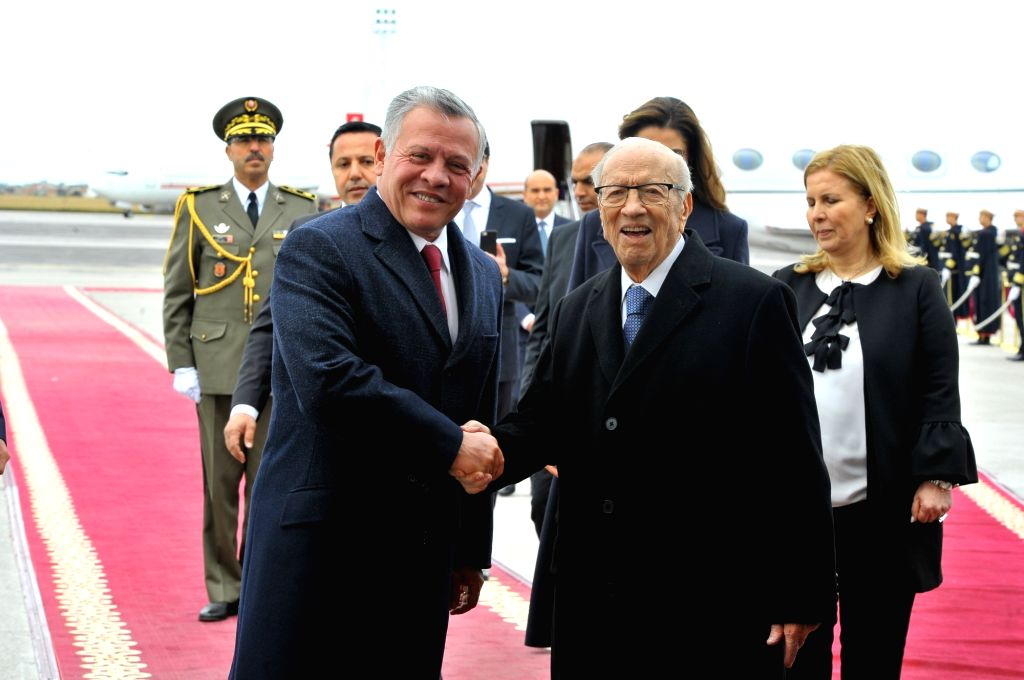 TUNIS, Feb. 3, 2019 - Tunisian President Beji Caid Essebsi (front, R) shakes hands with King Abdullah II of Jordan at the airport in Tunis, Tunisia, Feb. 3, 2019. At the invitation of Tunisian ...