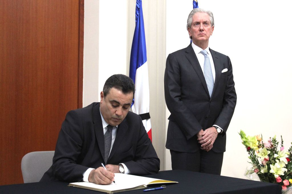 Tunisian Prime Minister Mehdi Jomaa (L) signs a guestbook at the French embassy in Tunisia, in Tunis City, Jan. 10, 2015. Mehdi Jomaa came here on Saturday to express - Mehdi Jomaa