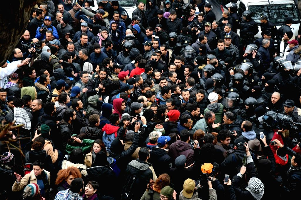 TUNIS, Jan. 13, 2018 (Xinhua) -- People take part in a protest in Tunis, capital of Tunisia, on Jan. 12, 2018. A total of 778 people have been arrested in Tunisia after three nights of clashes between protesters and security forces over price hikes,