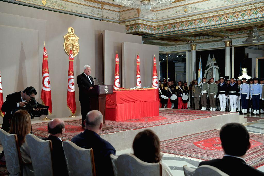 TUNIS, July 27, 2019 - Palestinian president Mahmoud Abbas (C) speaks during the state funeral of late Tunisian President Beji Caid Essebsi in Tunis, Tunisia, July 27, 2019. Tunisia on Saturday bid ...