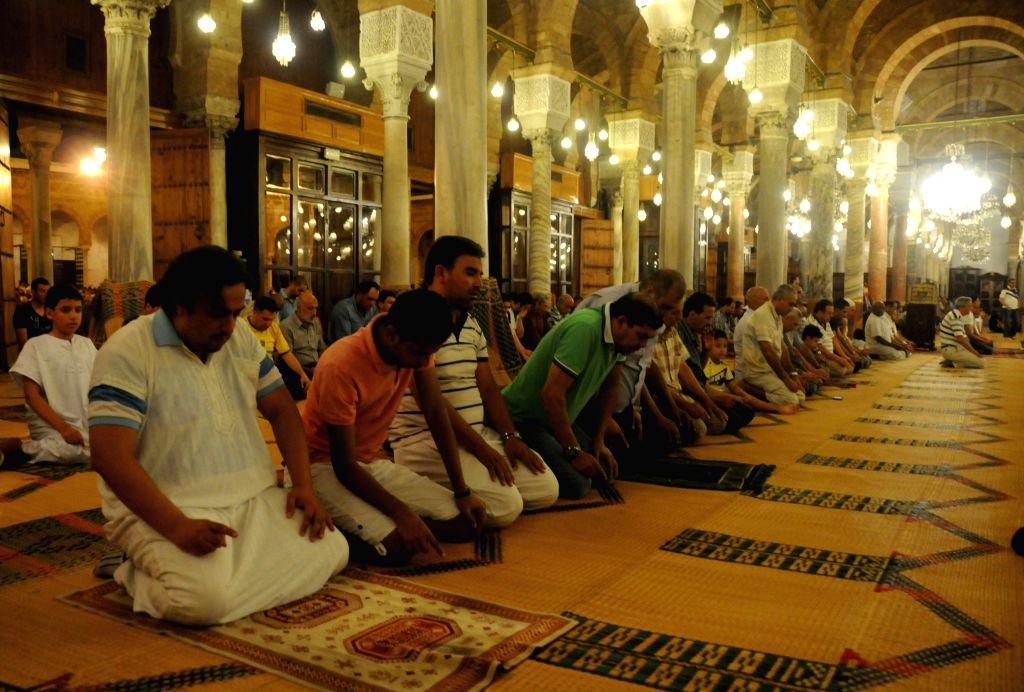 TUNIS, June 10, 2017 - Tunisian Muslims pray during the holy month of Ramadan at the Zitouna Mosque in Tunis, Tunisia, on June 9, 2017.
