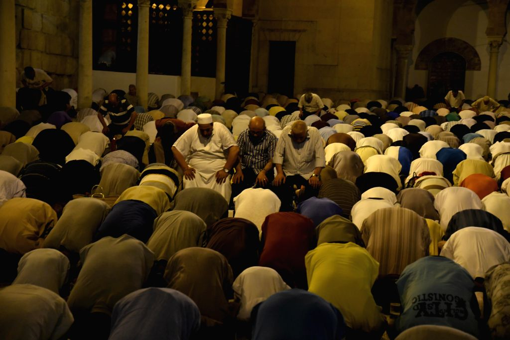 TUNIS, June 12, 2018 - Tunisian worshippers attend a night prayer during Laylat Al-Qadr, at Zitouna Mosque in Tunis, capital of Tunisia, on June 11, 2018. Laylat Al-Qadr is the holiest night in ...
