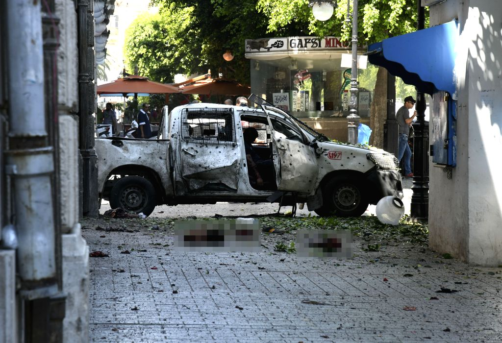 TUNIS, June 27, 2019 (Xinhua) -- Photo taken on June 27, 2019 shows the site of a bomb attack in Tunis, Tunisia. Two members of Tunisian security forces were injured Thursday in a suicide bomb attack on a police vehicle parked on Habib Bourguiba Stre