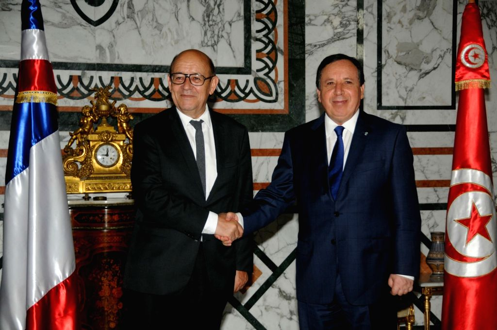 TUNIS, June 5, 2017 - Tunisian Foreign Minister Khemaies Jhinaoui (R) shakes hands with French Foreign Minister Jean-Yves Le Drian during Drian's official visit in Tunis, capital of Tunisia, on June ... - Khemaies Jhinaoui