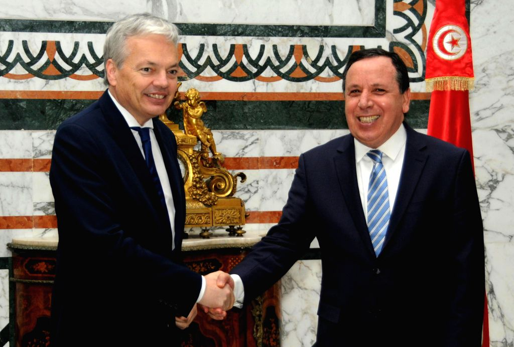 TUNIS, March 2, 2017 - Tunisian Foreign Minister Khemais Jhinaoui (R) shakes hands with his Belgian counterpart Didier Reynders during Reynders' official visit in the capital Tunis on March 1, 2017. - Khemais Jhinaoui