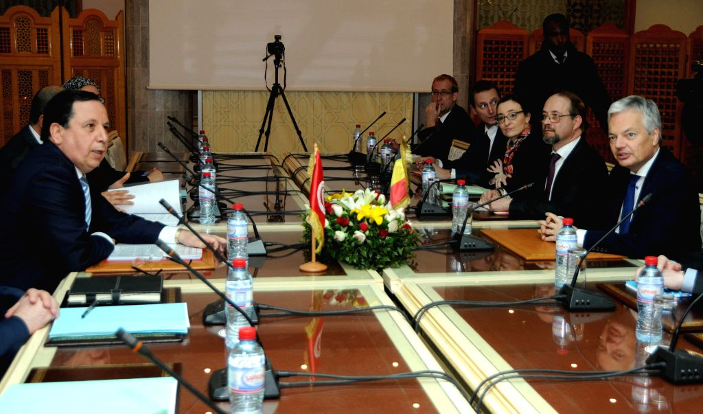 TUNIS, March 2, 2017 - Tunisian Foreign Minister Khemais Jhinaoui (1st L) meets with his Belgian counterpart Didier Reynders (1st R) during Reynders' official visit in the capital Tunis on March 1, ... - Khemais Jhinaoui