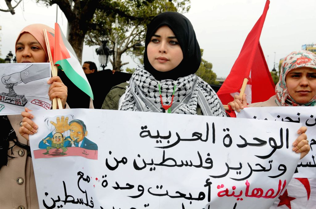 Tunisian People hold placards to support Hamas against Egypt's blacklisting in Tunis, Tunisia, March 6, 2015. The Cairo Court of Urgent Matters designated the ...