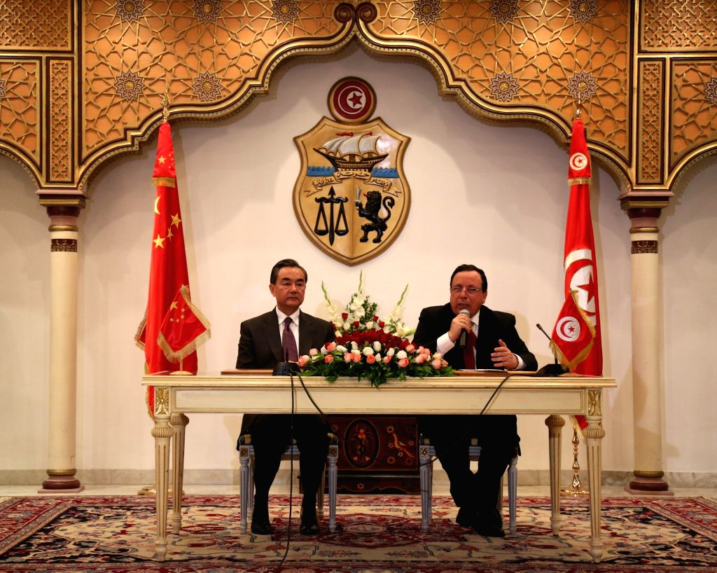 TUNIS, May 14, 2016 - Tunisian Foreign Minister Khemaies Jhinaoui (R) speaks during a joint press conference with his Chinese counterpart Wang Yi in Tunis, Tunisia, May 13, 2016. - Khemaies Jhinaoui