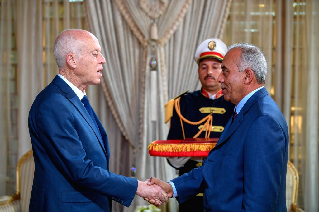 TUNIS, Nov. 15, 2019 - Tunisian President Kais Saied (L, Front) shakes hands with Habib Jemli during their meeting in Tunis, Tunisia, on Nov. 15, 2019. President Kais Saied officially approved Habib ...