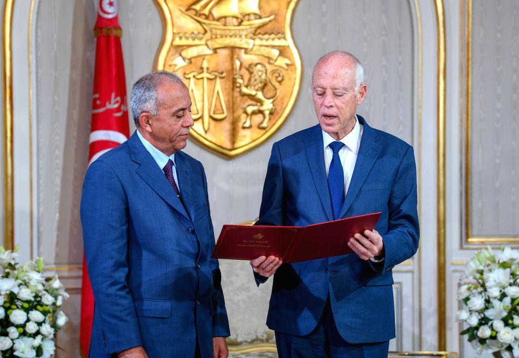 TUNIS, Nov. 15, 2019 - Tunisian President Kais Saied (R) meets with Habib Jemli in Tunis, Tunisia, on Nov. 15, 2019. President Kais Saied officially approved Habib Jemli on Friday to form the new ...
