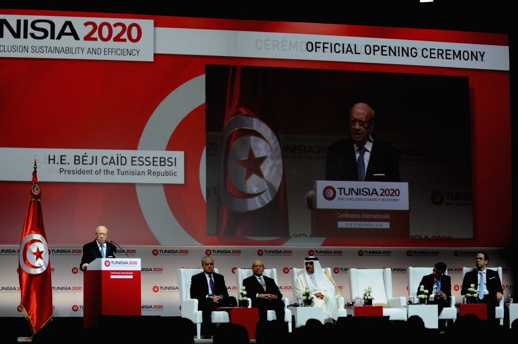 """TUNIS, Nov. 29, 2016 - Tunisian President Beji Caid Essebsi (L) gives a speech during the """"Tunisia 2020"""" Conference on Investment in the Congress Palace in Tunis, Tunisia, Nov. 29, 2016. ..."""