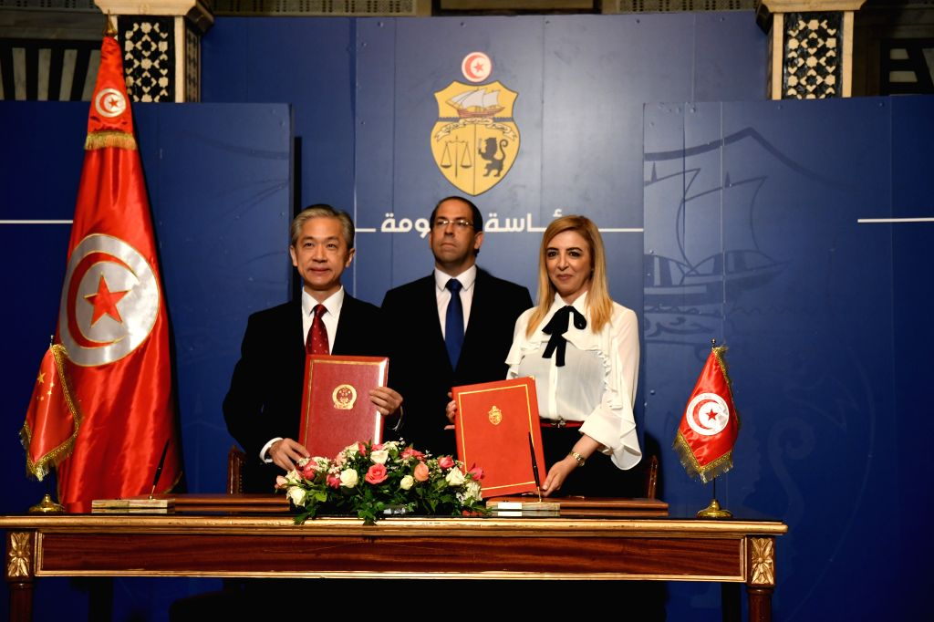 TUNIS, Oct. 8, 2019 - Chinese Ambassador to Tunisia Wang Wenbin (L), Tunisian Prime Minister Youssef Chahed (C) and Tunisian Acting Minister of Health Sonia Ben Sheikh pose for a photo during an ... - Youssef Chahed and Sonia Ben Sheikh