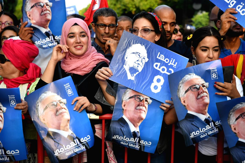 TUNIS, Sept. 13, 2019 - Supporters attend a presidential election campaign in Tunis, Tunisia, on Sept. 13, 2019. There are 26 candidates running for the presidential election scheduled on Sept. 15 ...