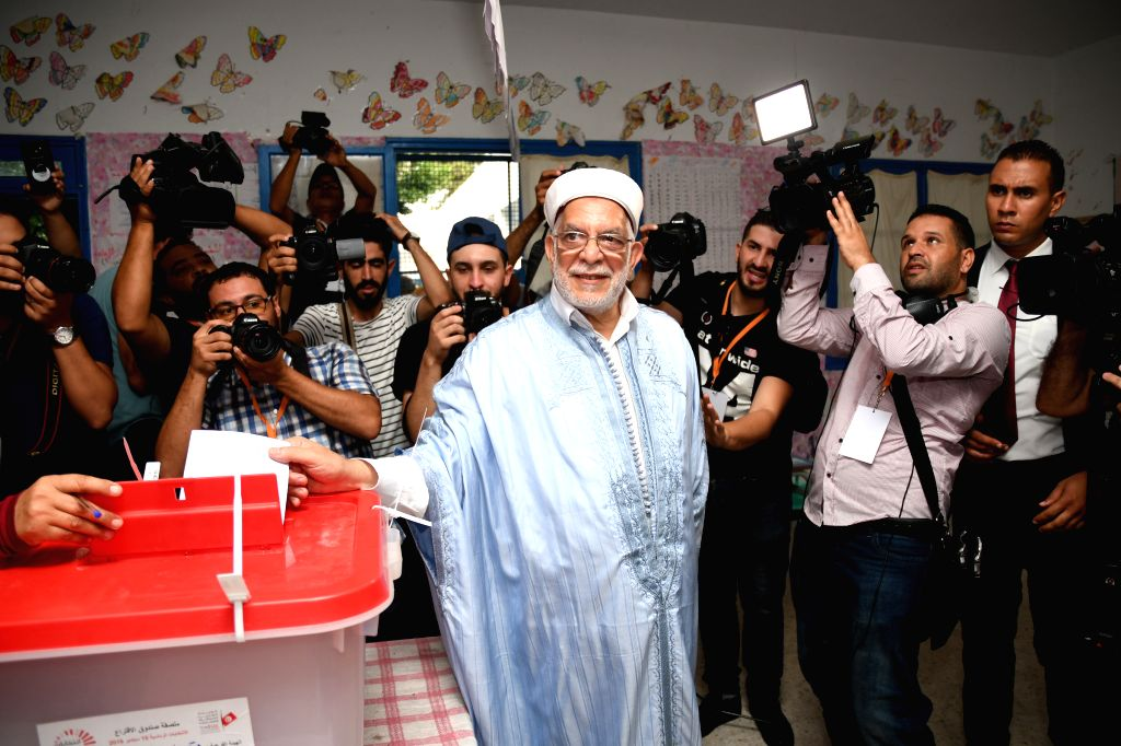 TUNIS, Sept. 15, 2019 - The presidential candidate Abdelfattah Mourou casts his ballot at a polling center in Tunis, Tunisia, Sept. 15, 2019. The polling centers for the early presidential election ...
