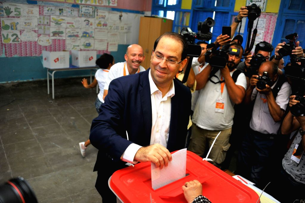 TUNIS, Sept. 15, 2019 - The presidential candidate, also Tunisian Prime Minister Youssef Chahed casts his ballot at a polling center in Tunis, Tunisia, Sept. 15, 2019. The polling centers for the ... - Youssef Chahed