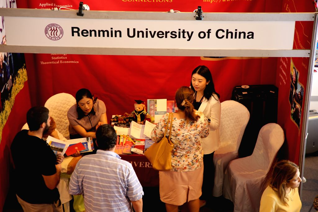 "TUNIS, Sept. 3, 2019 - Tunisian students consult representatives from Renmin University of China on studying information at the exhibition of ""China Campus 2019"" in Tunis, Tunisia, on Sept. ..."