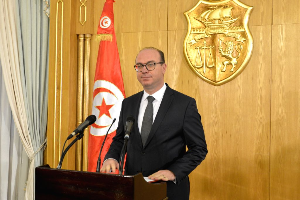 Tunisia's Prime Minister-designate Elyes Fakhfakh speaks during a press conference in Tunis, Tunisia, Jan. 24, 2020. He announced Friday that the number of ministers ...