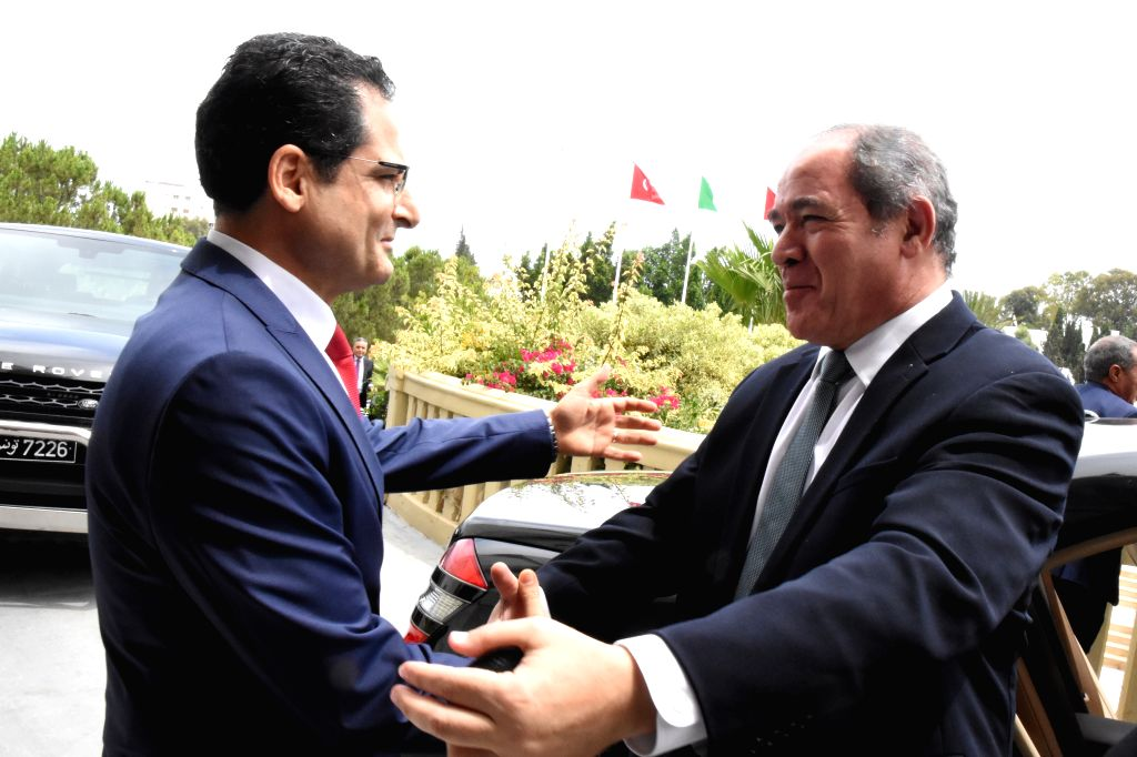 Tunisian Foreign Minister Noureddine Erray (L) welcomes Algerian Foreign Minister Sabri Boukadoum in Tunis, Tunisia, on July 13, 2020. - Noureddine Erray