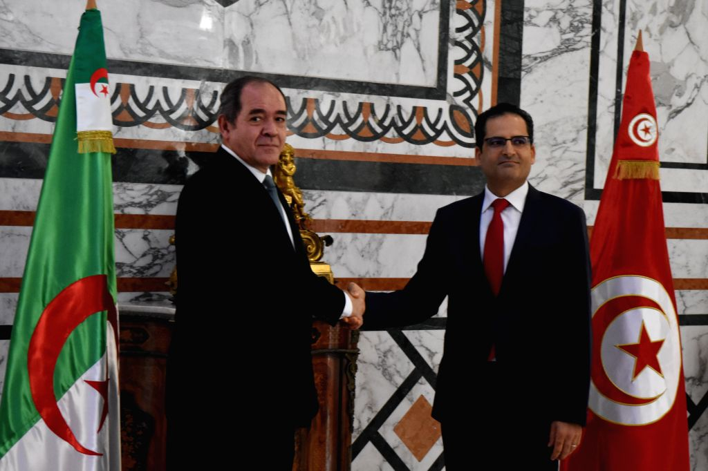 Tunisian Foreign Minister Noureddine Erray (R) shakes hands with Algerian Foreign Minister Sabri Boukadoum during their meeting in Tunis, Tunisia, on July 13, 2020. - Noureddine Erray