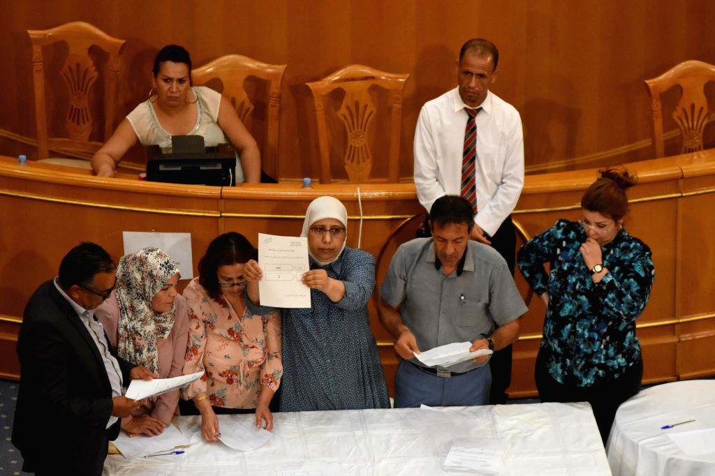 Tunisian parliament staff count votes in the parliament in Tunis, Tunisia, on July 30, 2020. Tunisian Parliament Speaker Rached Ghannouchi has retained his post ... - Rached Ghannouchi