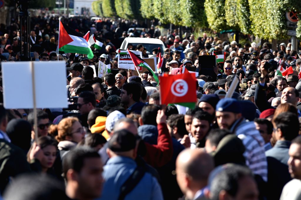 Tunisians take part in a rally to protest against the U.S. Middle East peace plan in Tunis, capital of Tunisia, on Feb. 5, 2020. Hundreds of Tunisians on Wednesday ...
