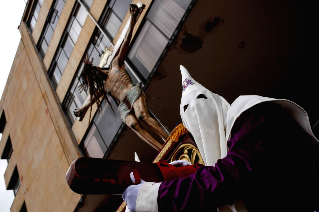 A local participates in a procession to commemorate Good Friday, in Tunja, capital of Boyaca, Colombia, on April 18, 2014.