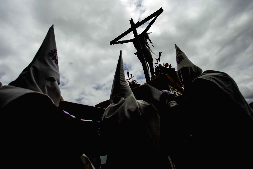 Locals participate in a procession to commemorate Good Friday, in Tunja, capital of Boyaca, Colombia, on April 18, 2014.