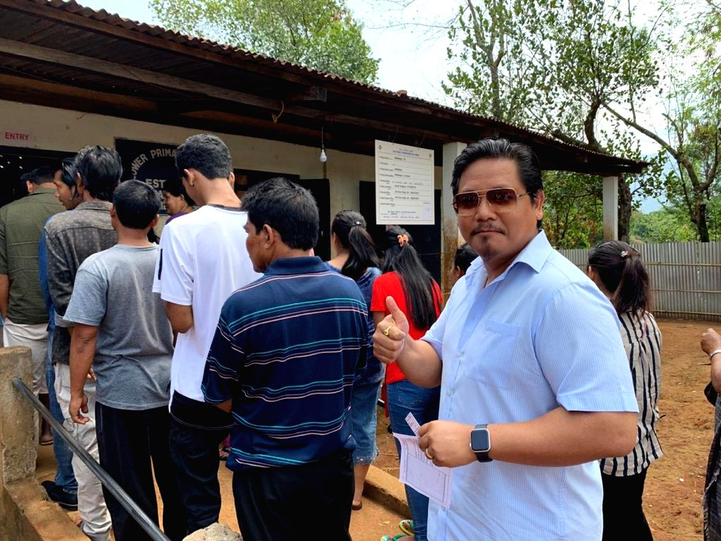 Tura: Meghalaya Chief Minister Conrad Sangma stand in queue to cast vote for Lok Sabha election at a polling station in Meghalaya's Tura, on April 11, 2019. (Photo: IANS) - Conrad Sangma