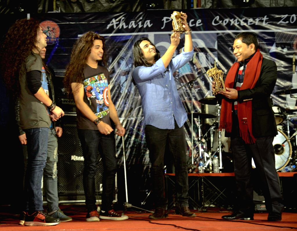 Meghalaya Chief Minister Mukul Sangma felicitates the members of a music band during the concluding day of Ahaia Winter Festival at Tura in Meghalaya on Dec 20, 2014. - Mukul Sangma