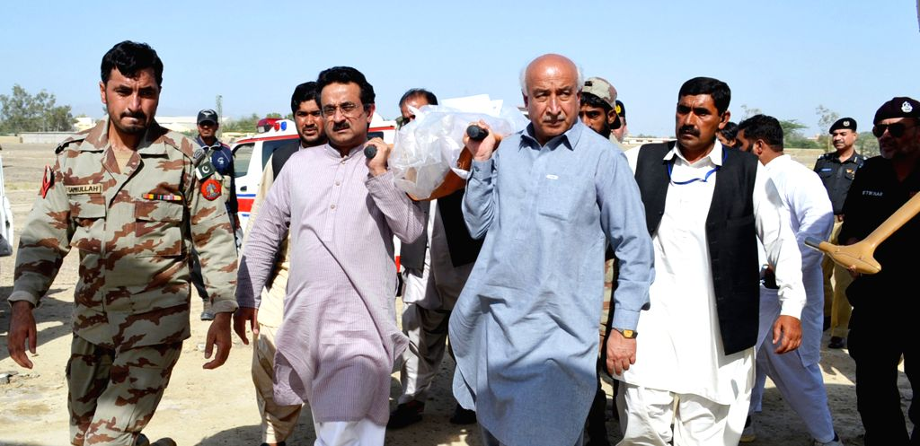Photo released by Press Information Department (PID) on April 11, 2015 shows Chief Minister Balochistan Dr. Abdul Malik Baloch (C, in blue) and other government ... - Balochistan D and Malik