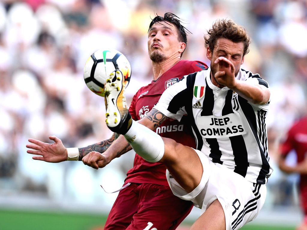TURIN, Aug. 20, 2017 - Cagliari's Fabio Pisacane (L) vies with Juventus' Claudio Marchisio during the Serie A soccer match between Juventus and Cagliari in Turin, Italy, Aug. 19, 2017. Juventus won ...