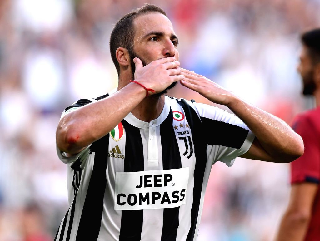 TURIN, Aug. 20, 2017 - Juventus' Gonzalo Higuain celebrates after scoring during the Serie A soccer match between Juventus and Cagliari in Turin, Italy, Aug. 19, 2017. Juventus won 3-0.