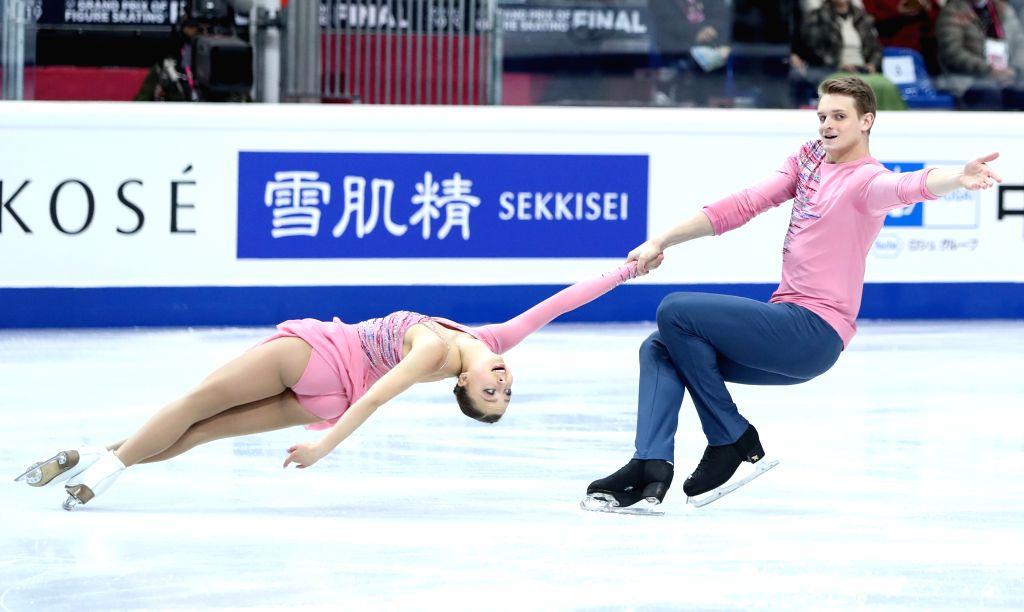 TURIN, Dec. 6, 2019 - Aleksandra Boikova (L)/Dmitrii Kozlovskii of Russia compete during the pairs short program at the ISU Grand Prix of Figure Skating Final 2019 in Turin, Italy, Dec. 5, 2019.