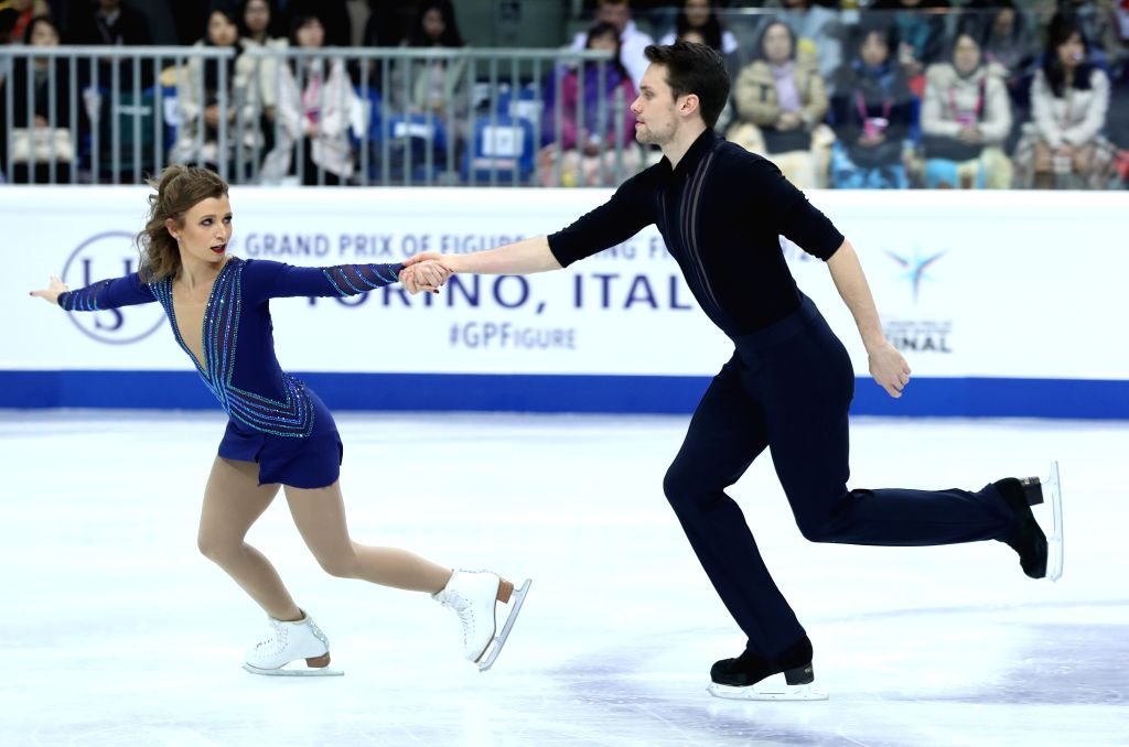 TURIN, Dec. 6, 2019 - Kirsten Moore-Towers(L)/Michael Marinaro of Canada compete during the pairs short program at the ISU Grand Prix of Figure Skating Final 2019 in Turin, Italy, Dec. 5, 2019.